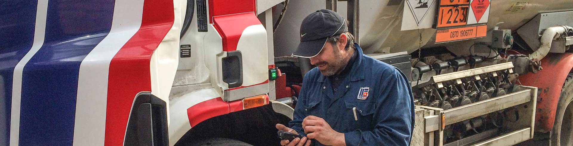 how it works. man with handheld device beside truck
