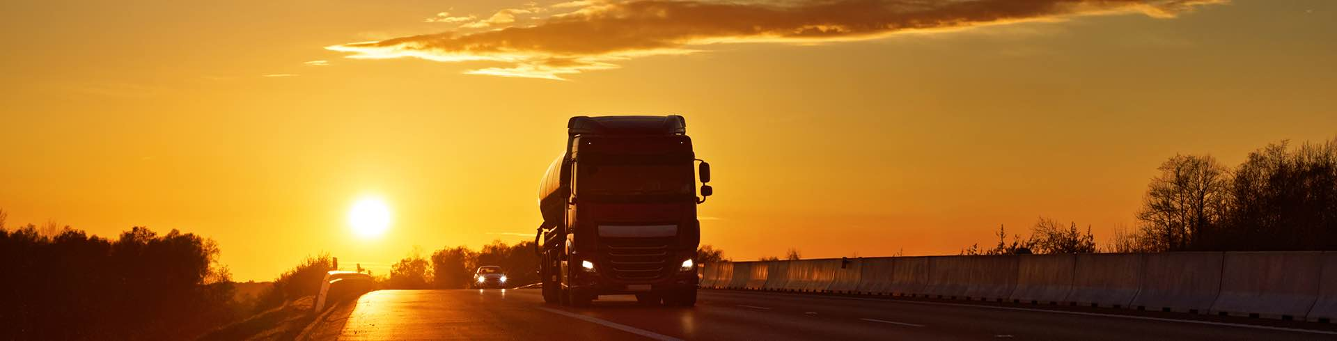 truck-driving-at-sunset